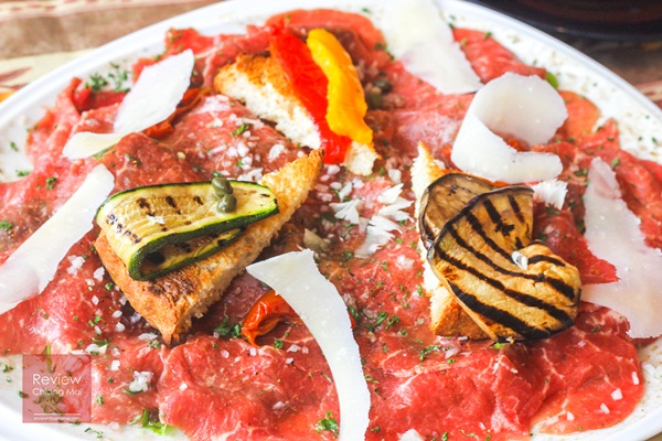 Beef Carpaccio on salad with grilled vegetable and parmesan cheese